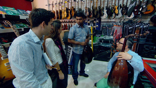 Jason Leech, Luisa Zissman and Jordan Poulton negotiating for a musical item for a hotel in Episode 5 of The Apprentice 2013