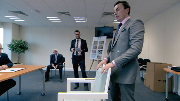 Jordan Poulton and Alex Mills pitch their furniture design as Nick Hewer looks on in The Apprentice 2013 Episode 3
