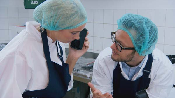 Leah Totton and  Jordan Poulton exploring recipes in The Apprentice 2013 episode 9